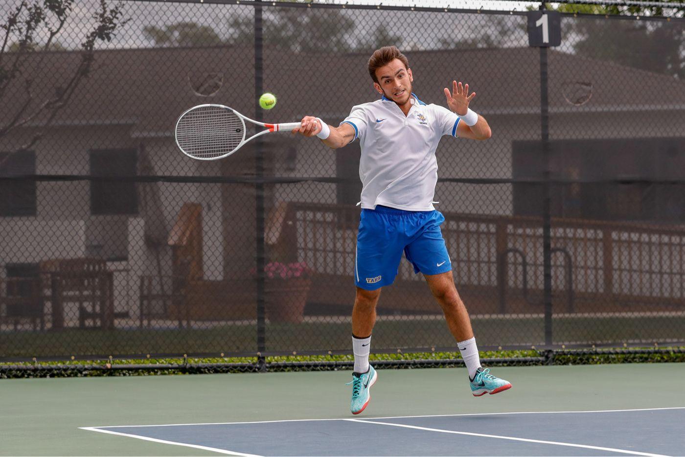 A tennis player hitting a ball during a game.
