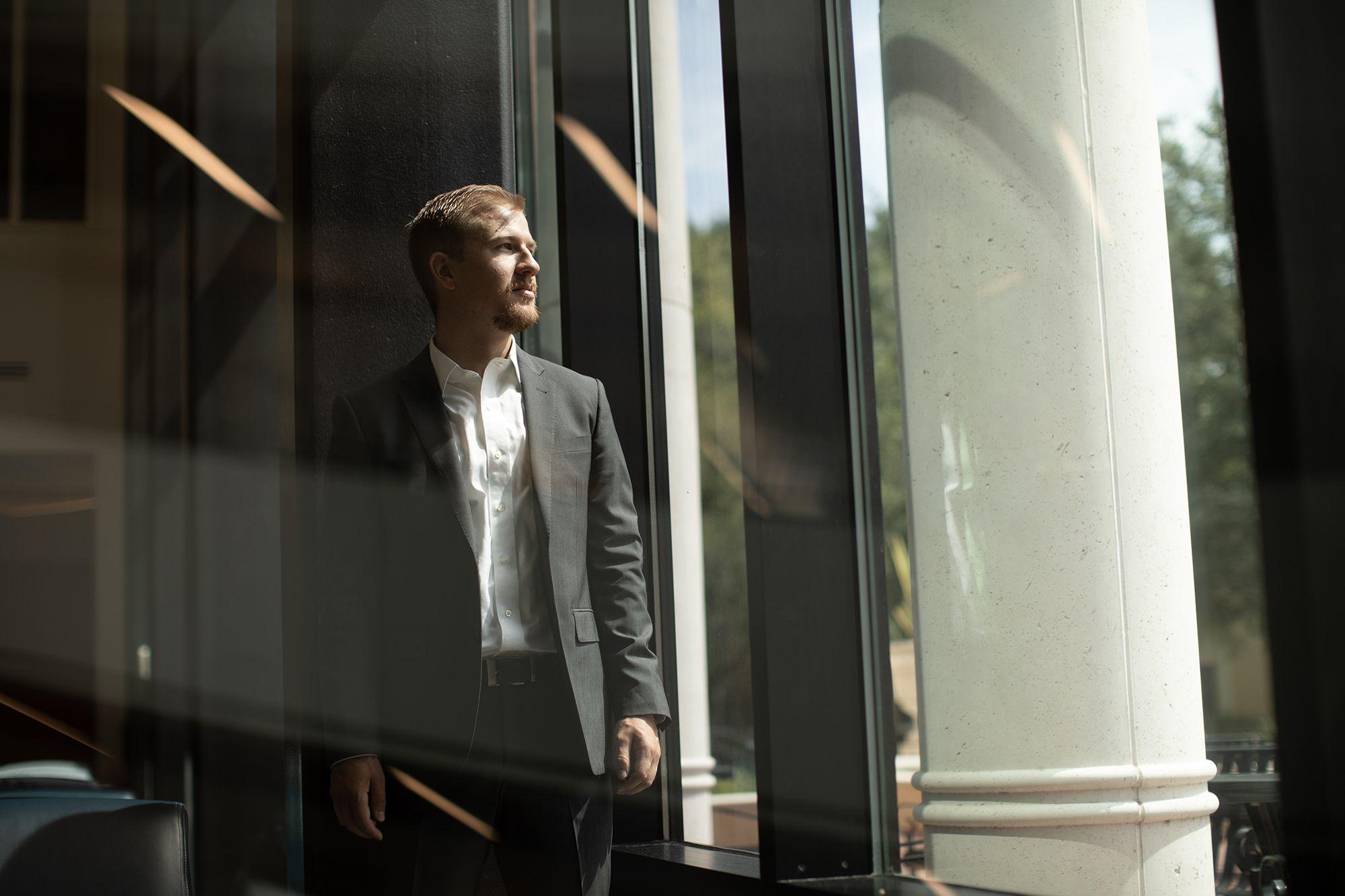 Caleb Archuleta gazes out a window in the Bush Science Center.