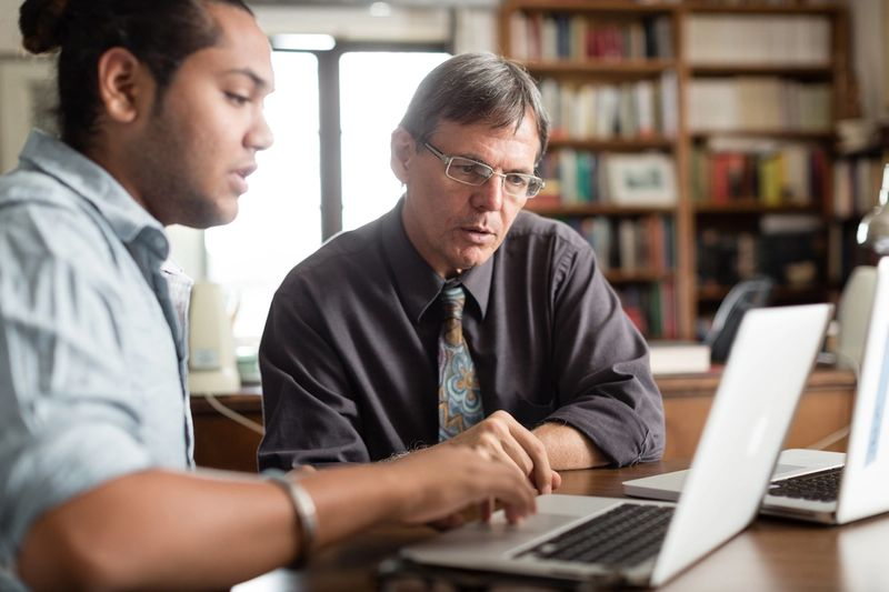 An advisor helps a student construct a personalized academic roadmap.
