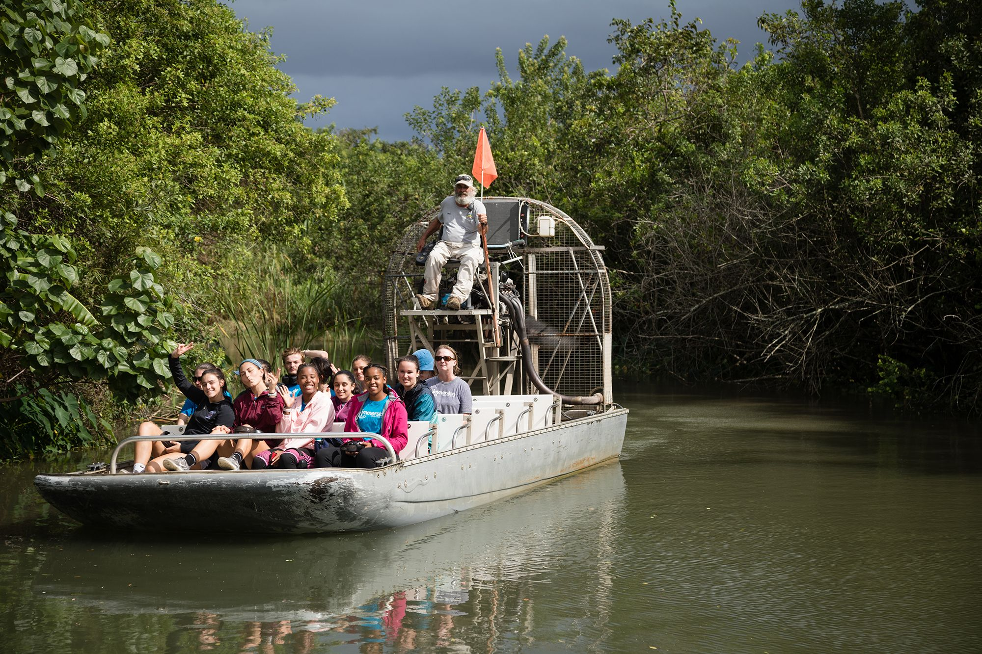 Students ride an airboat on an Immersion experience in the Everglades.