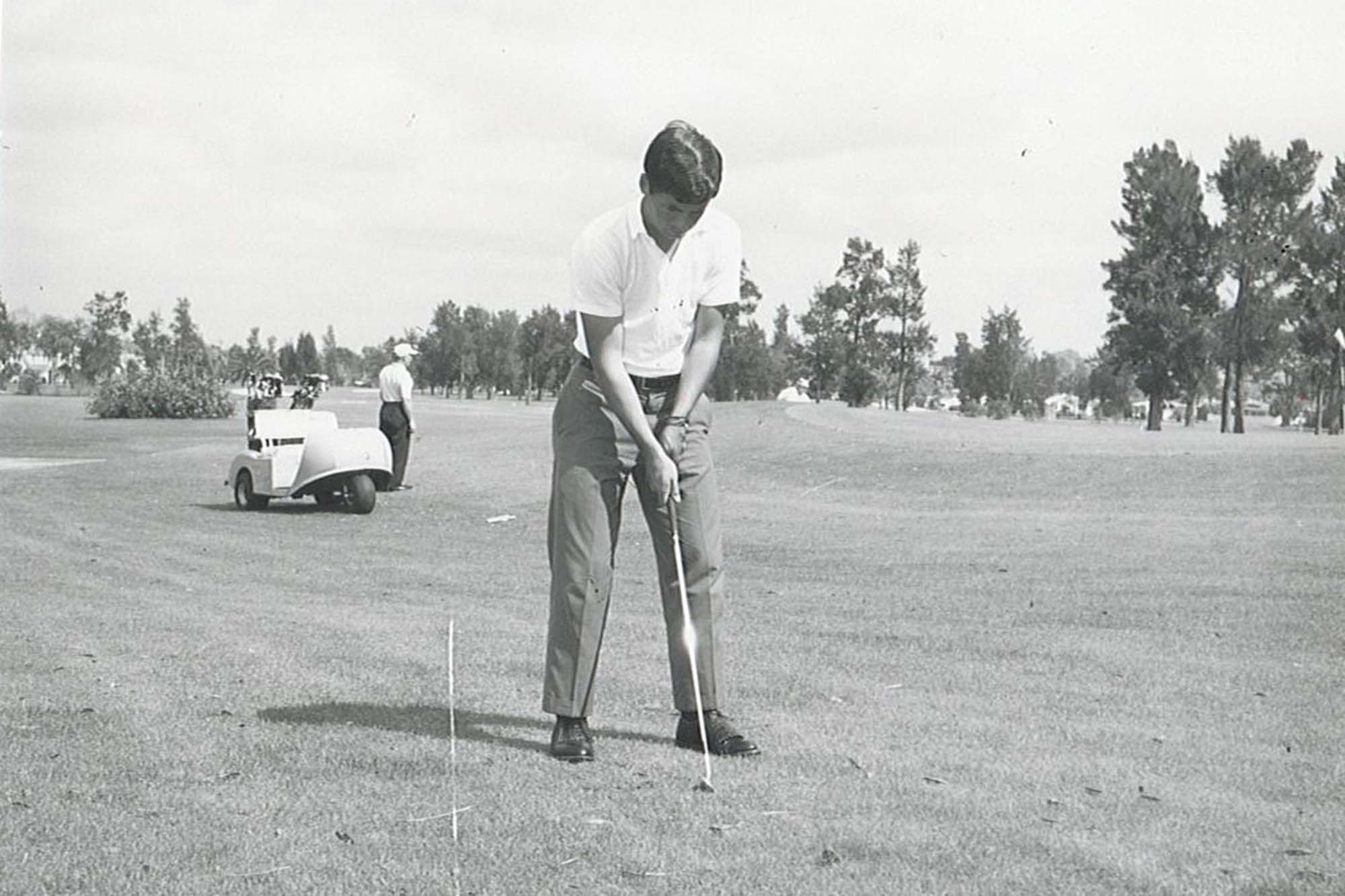 Bob Lewis playing a round during his time on the Rollins golf team in 1966