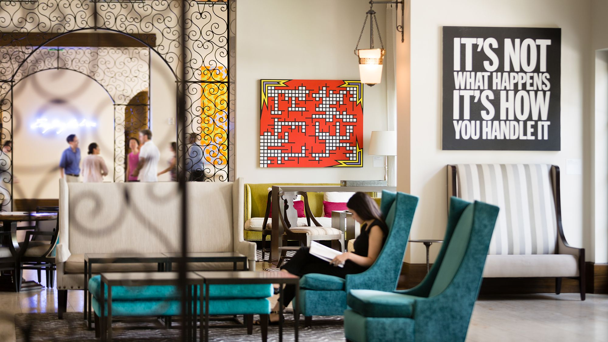 A guest reads a book in the lobby of the Alfond Inn.