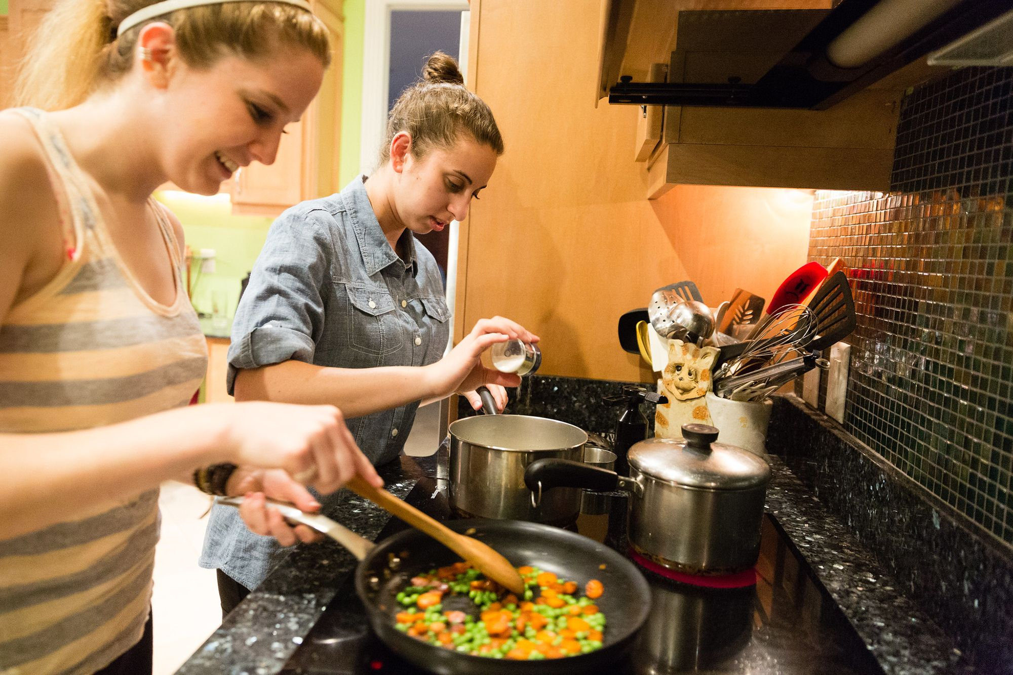 Students cooking dinner together.