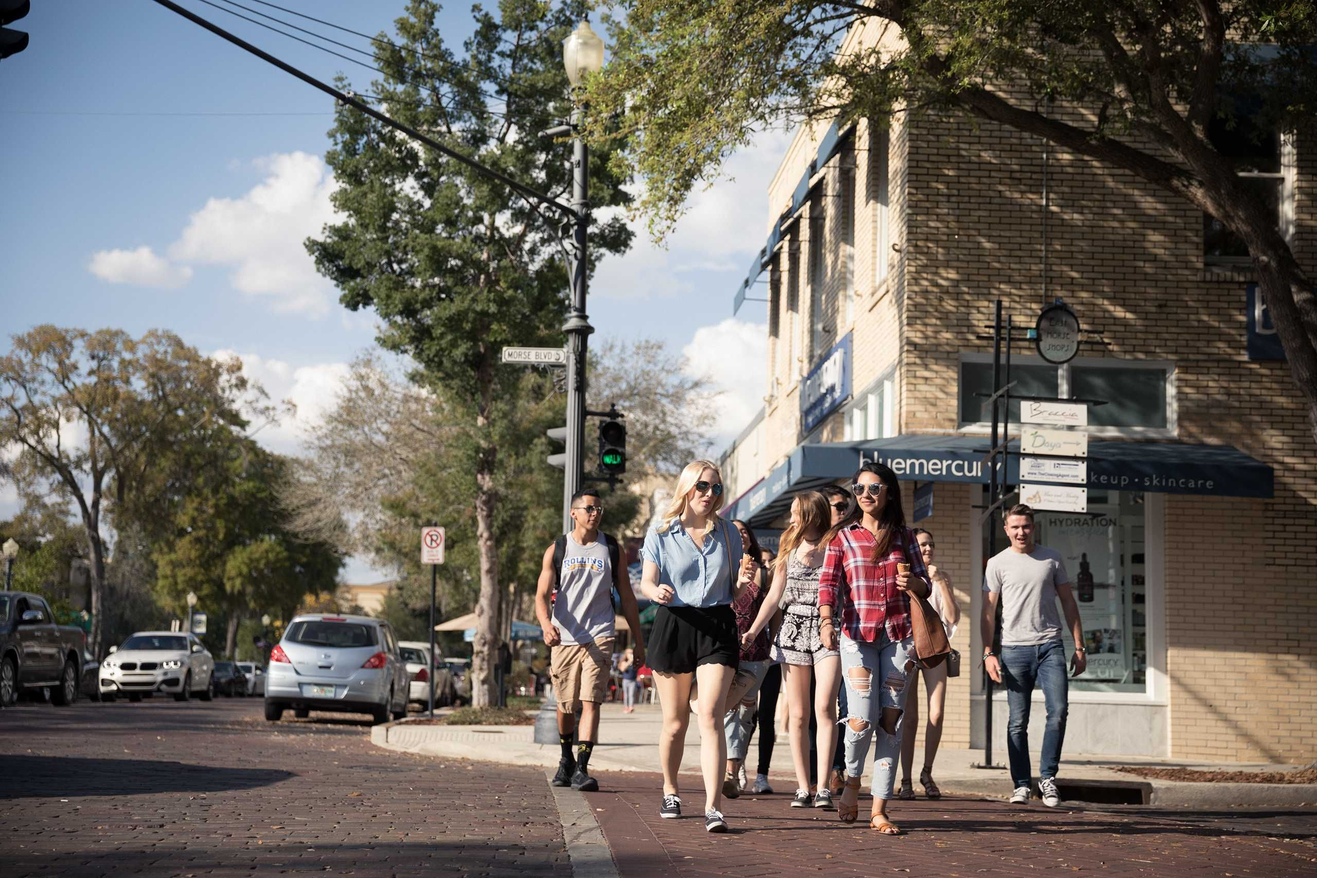 Students walk on Park Avenue in downtown Winter Park