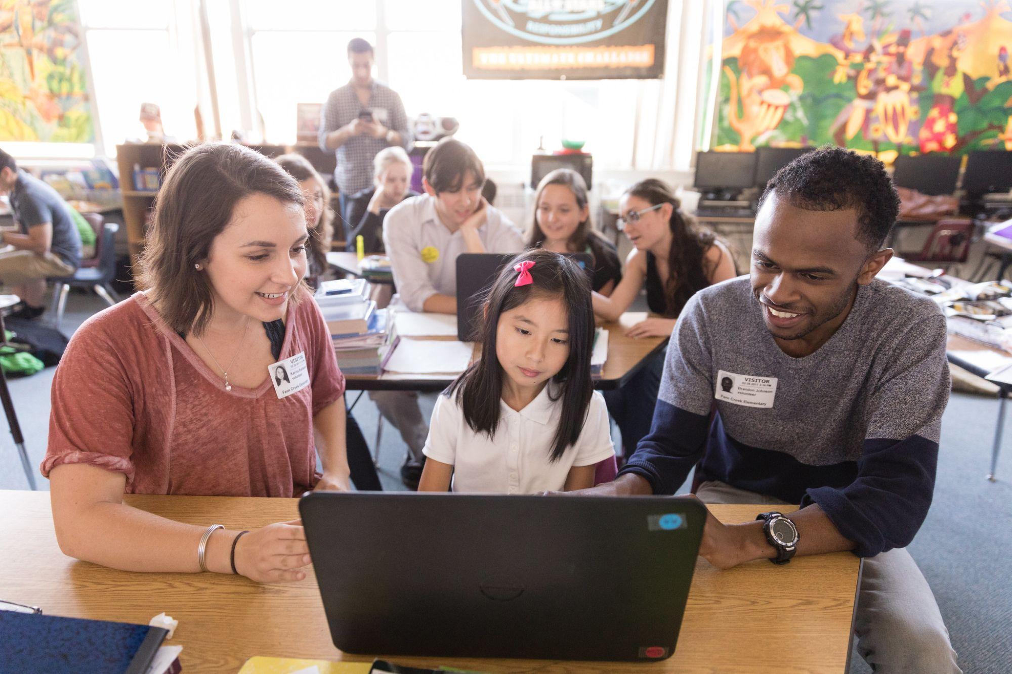 Karina Barbesino teaches the basics of coding to students at Fern Creek Elementary.