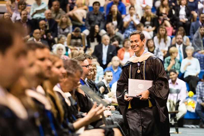 Rollins student graduates with an MBA from the Crummer Graduate School of Business.