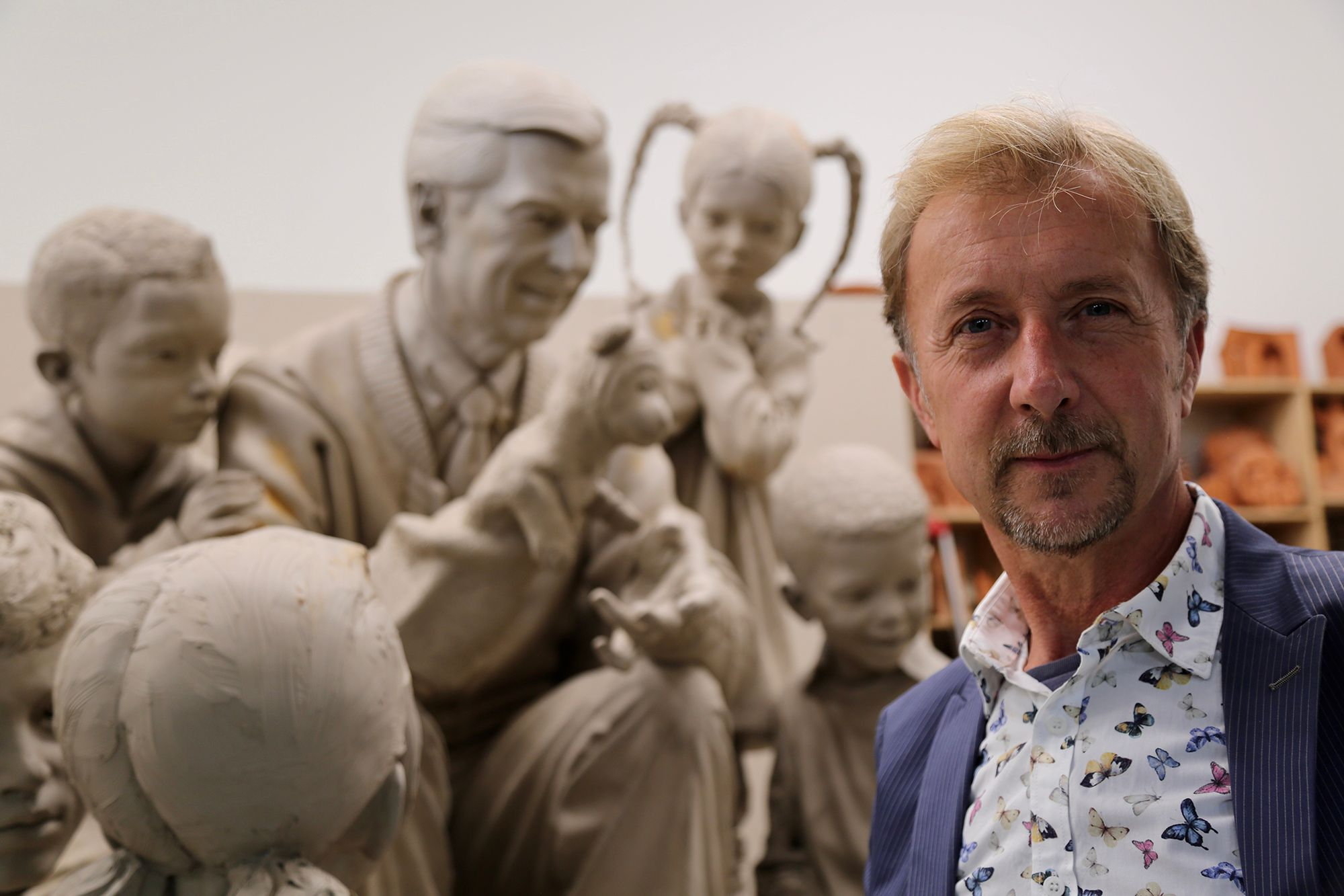 Artist Paul Day pictured with the statue he sculpted of Mister Rogers, Rollins' most beloved alumnus.