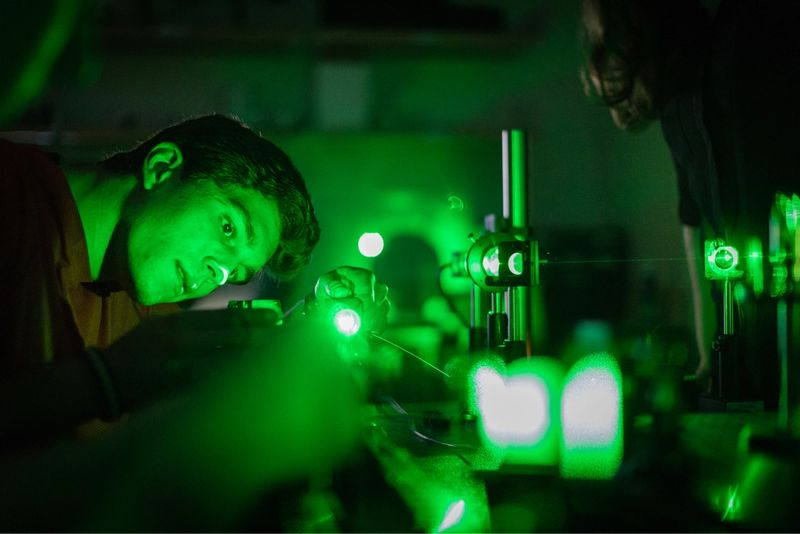 A student participates in research with lasers led by physics professor Ashley Cannaday.