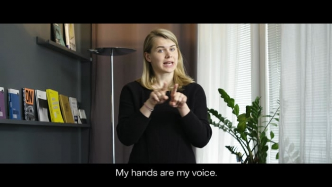 a woman gesturing hand-sign language