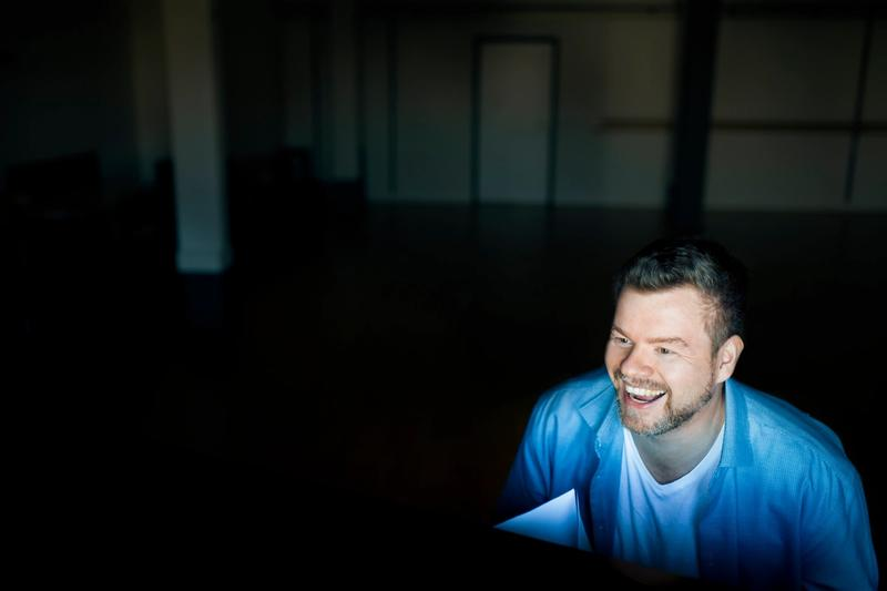 Main image of Christian Schleicher sitting at a piano