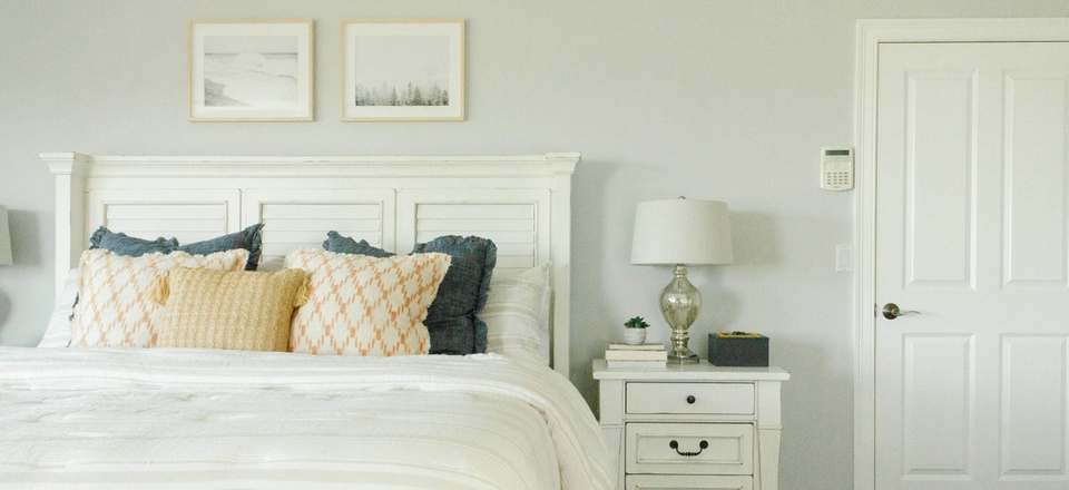 Bedroom nightstand and bed