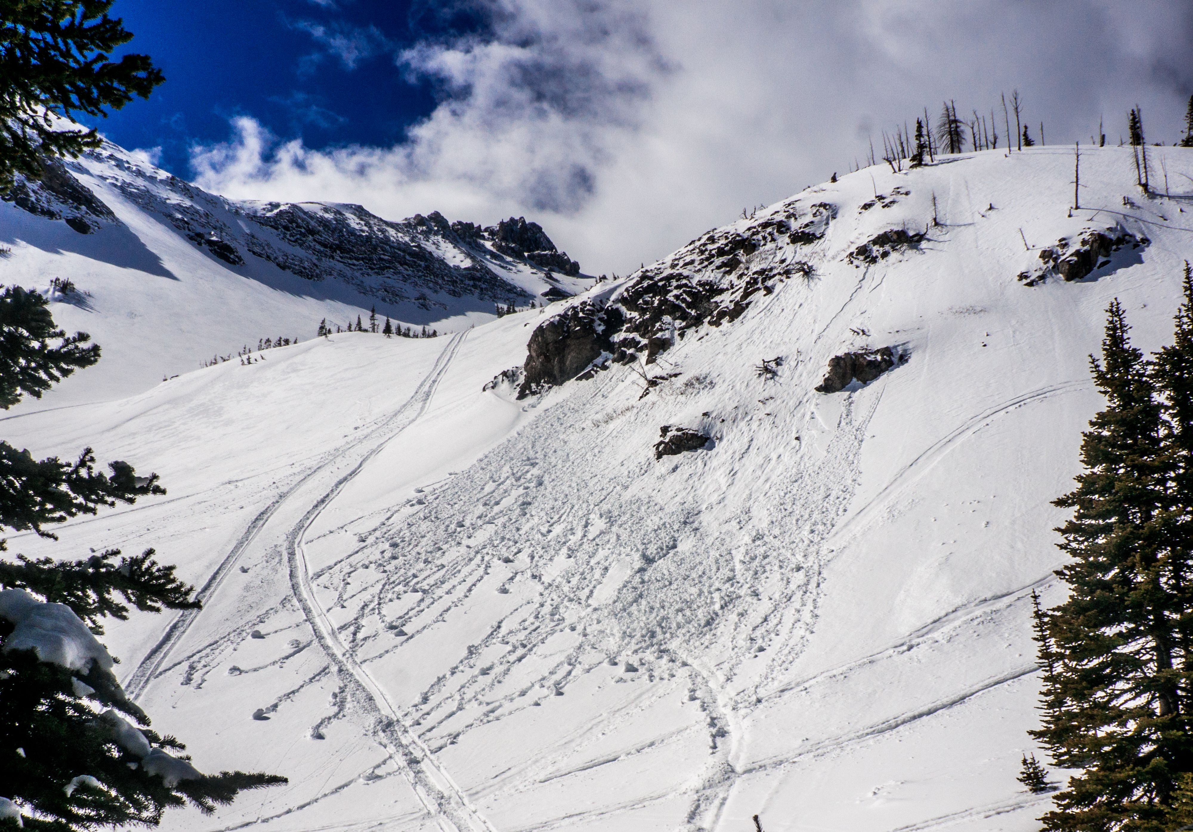 Snowballs rolling down a slope are a dependable sign that the sun is warming and weakening the snowpack.