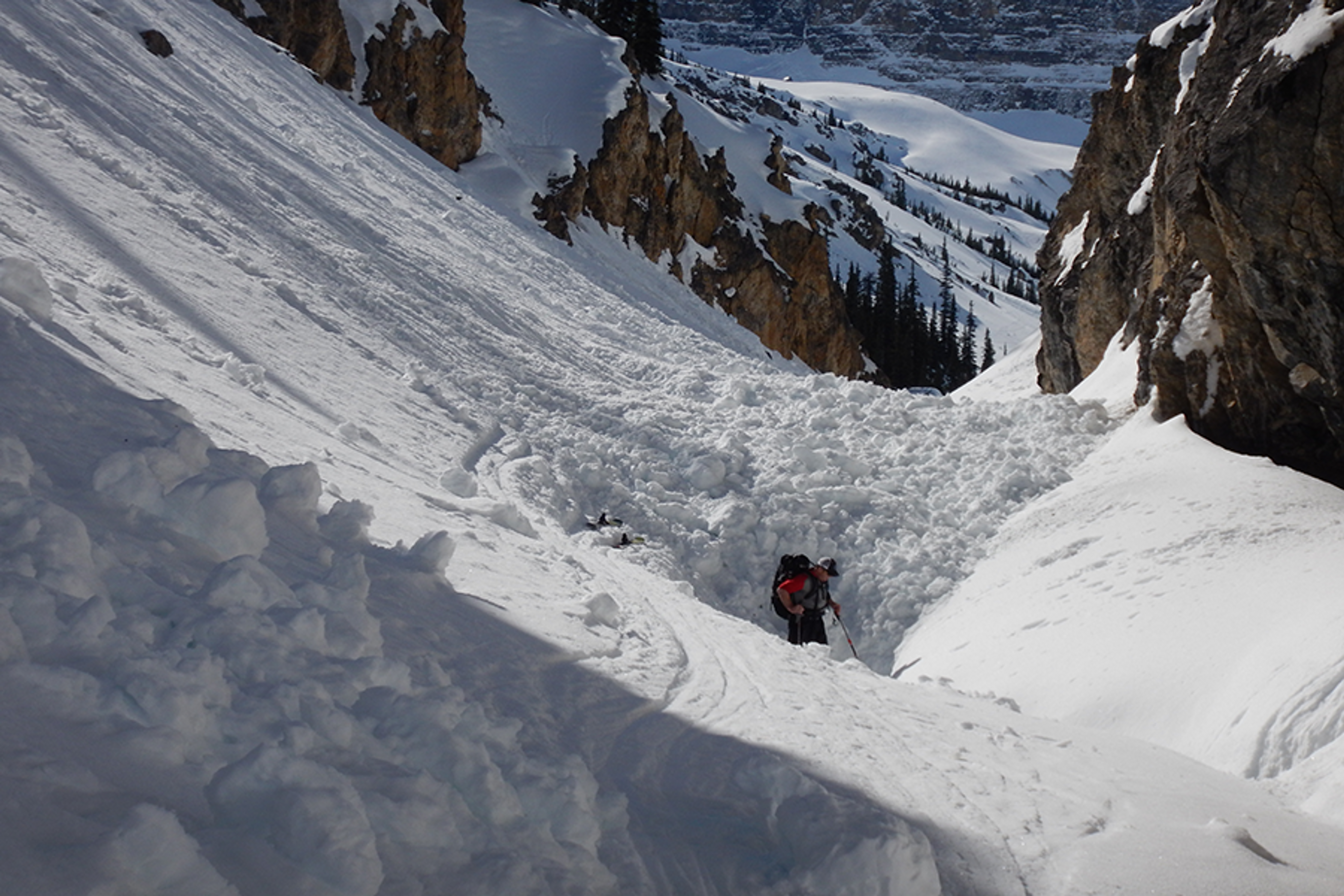 This is a classic terrain trap, where an avalanche from above piled up deeply in the gully. It would have resulted in a full burial for anyone caught in its path.