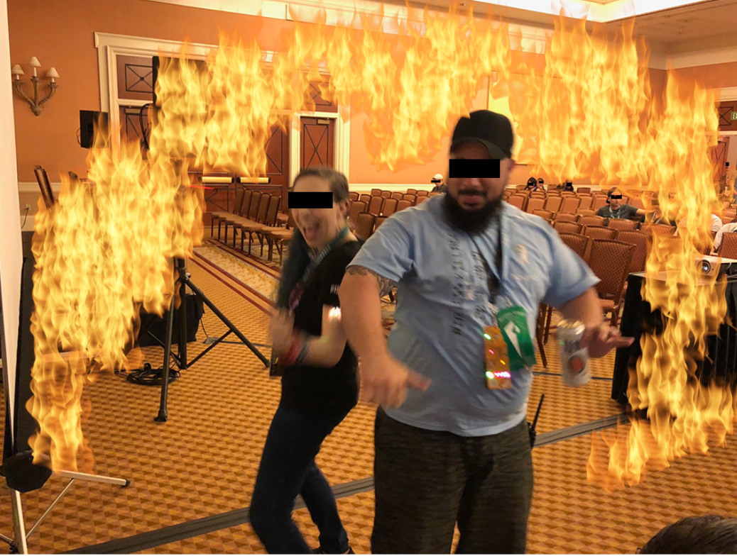a woman and a man dancing in an empty room with a fire image effect around them