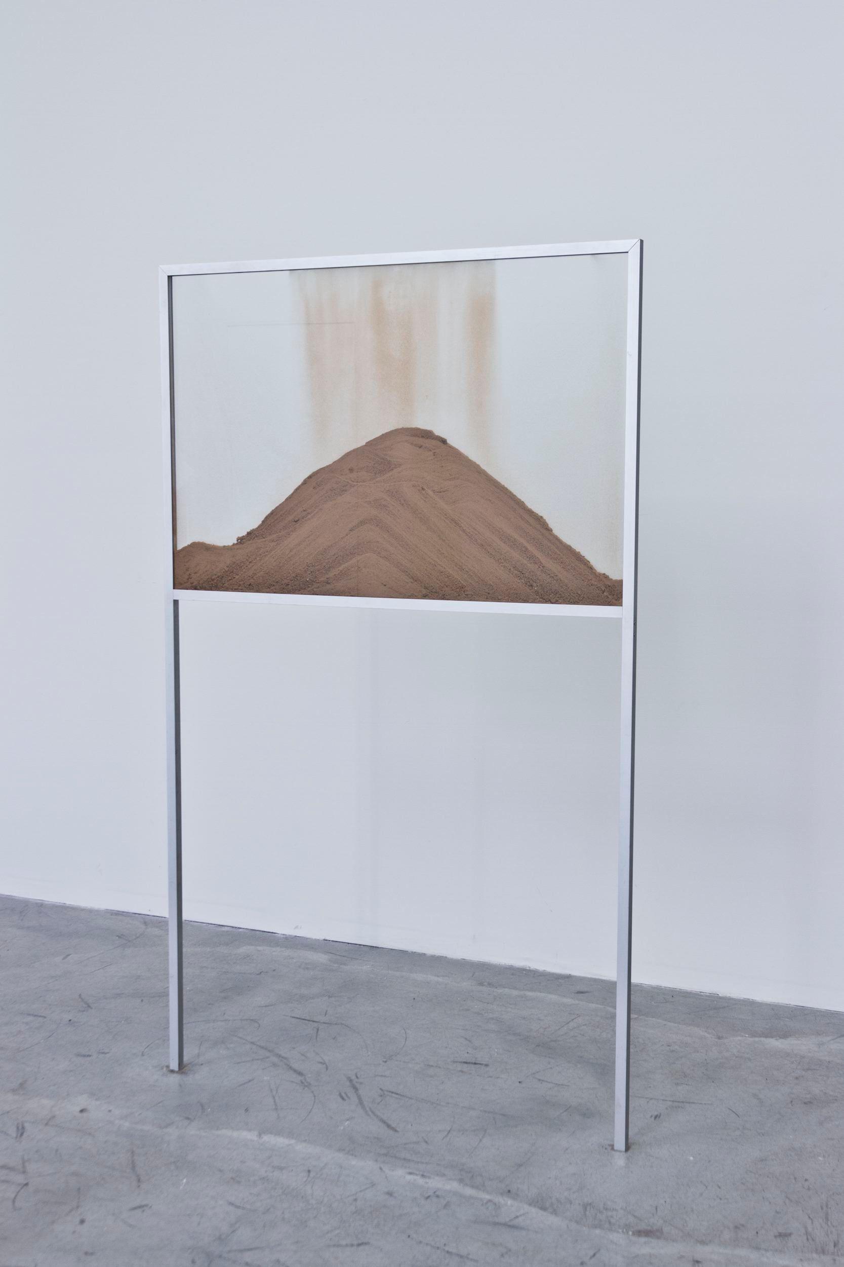 A World Undone [Protolith] | Zircone, glass, metal, film on HD colour, silent, loop | 150 x 90 x 3 cm | 2012