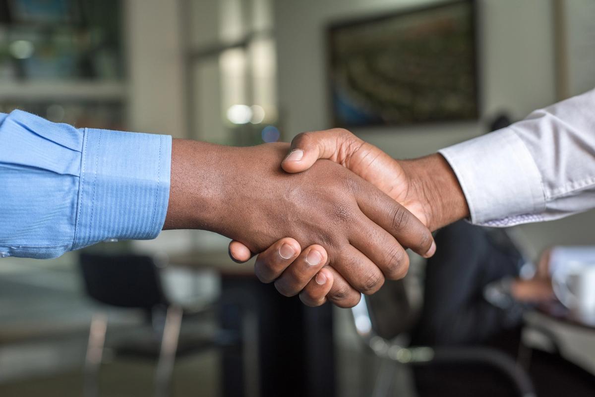 Handshake welcoming a new starter