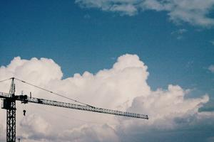 A crane with clouds in the background