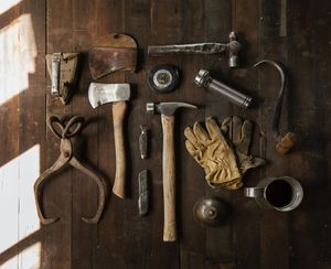 Tools laid out on a wooden table