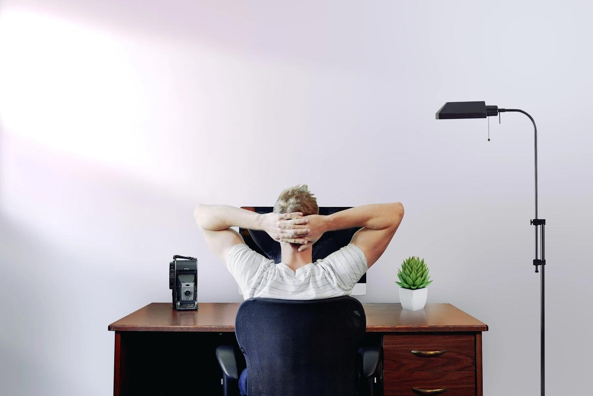Man sitting at desk - supporting staff to prevent burnout