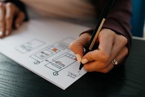 Designer drawing wireframes