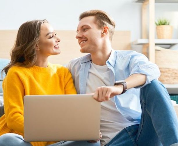 Couple creating to-do list for a smooth moving process.