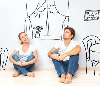 Couple thinking if now is the best time to buy a home.