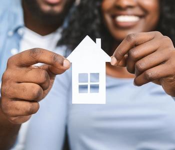 Couple holding VA home loan concept.
