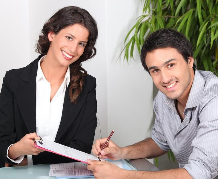 Real estate agent with a client discussing about title insurance.