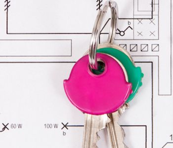 Home keys placed above house plan.