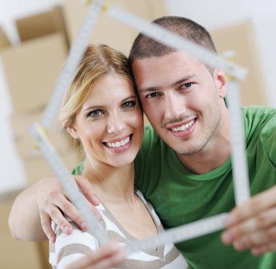 Couple holding house illustration.