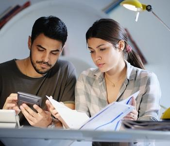 Couple going over home equity loan documents.