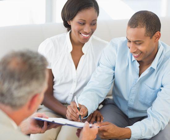 VA Loan specialist handling document to homebuyers.
