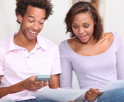 Couple looking over documents for mortgage loan