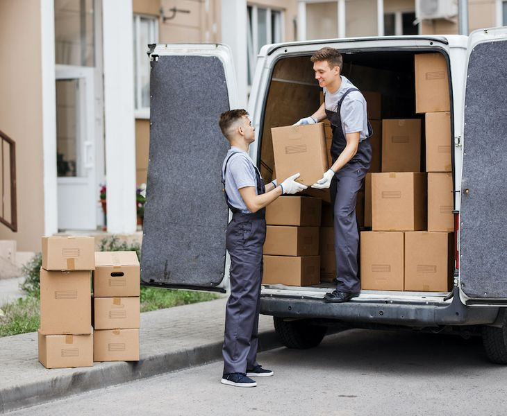Movers piling boxes - tips for smoothly moving to a new house.
