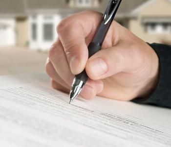 Signing title insurance document.