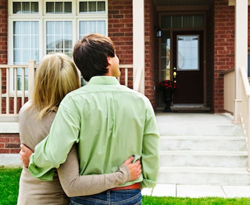 Couple looking at their newly bought house.