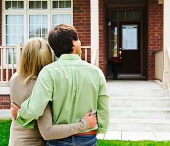 Couple looking at the newly bought house.