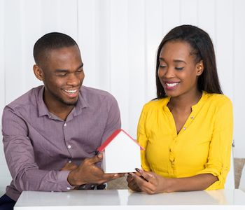 Couple discussing about VA Home loan appraisal process.