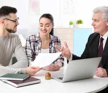 Couple discussing mortgage with a VA lender in Arizona.