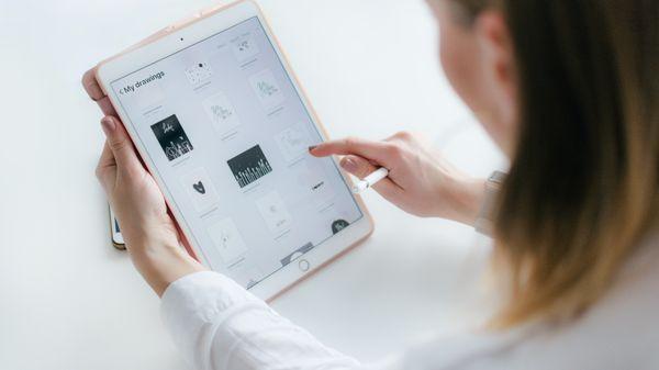 Woman reading iPad