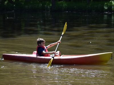 camper canoeing on the lake at Rambling Pines Day Camp