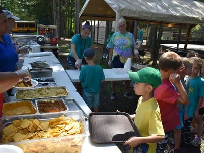 child getting lunch at Rambling Pines Day Camp