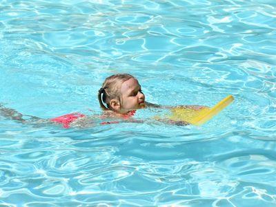 child swimming at Rambling Pines Day Camp