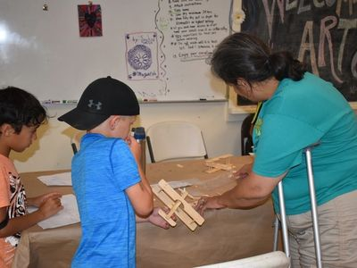 child doing woodcrafts at Rambling Pines Day Camp