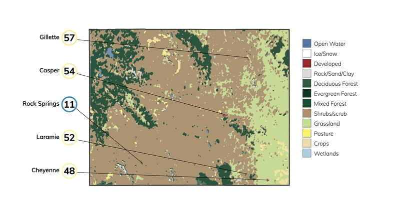 Map showing land cover in Wyoming and typical fire risk, out of 100, for buildings at risk in different cities in Wyoming.