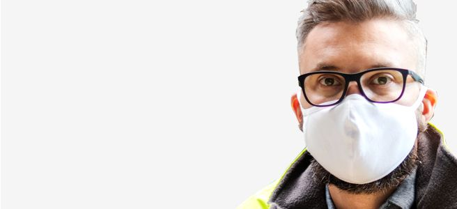 Man wearing mask and anti-fog glasses