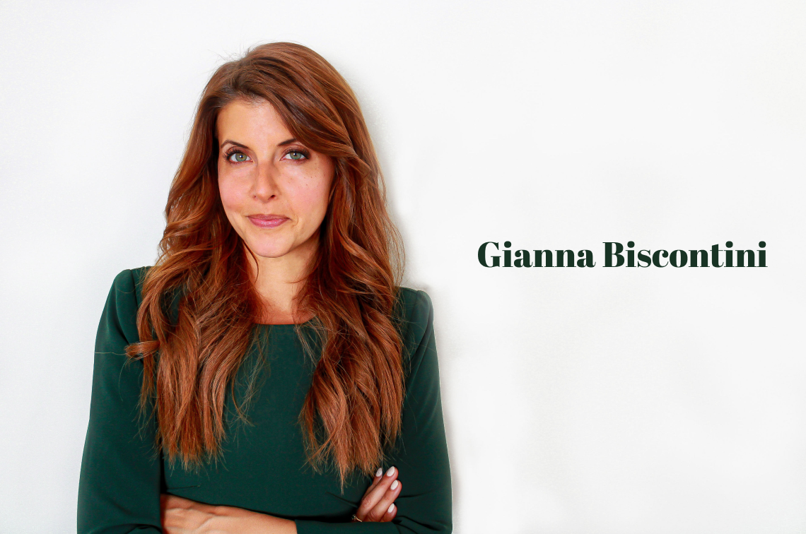 """Woman in green dress with text """"Gianna Biscontini"""" to the right"""
