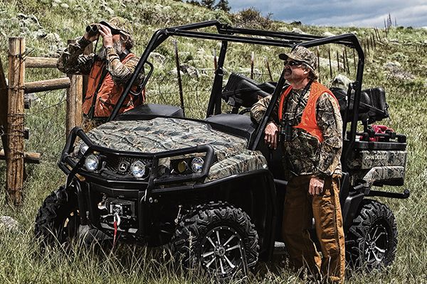 Men hunting with a John Deere XUV Series Gator