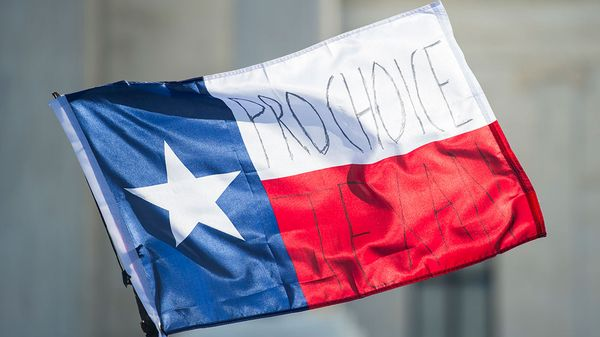 Pro-choice Texans written on a Texas flag