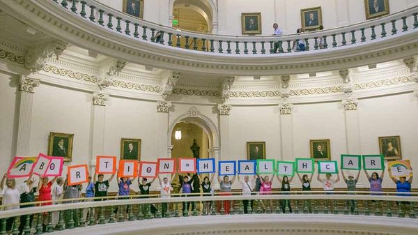 Reproductive freedom advocates gather at the rotunda at the Texas Capitol